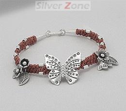 Bratara in stil tribal din sfoara portocalie cerata impletita cu pandantive din argint: flori, frunze si fluture
